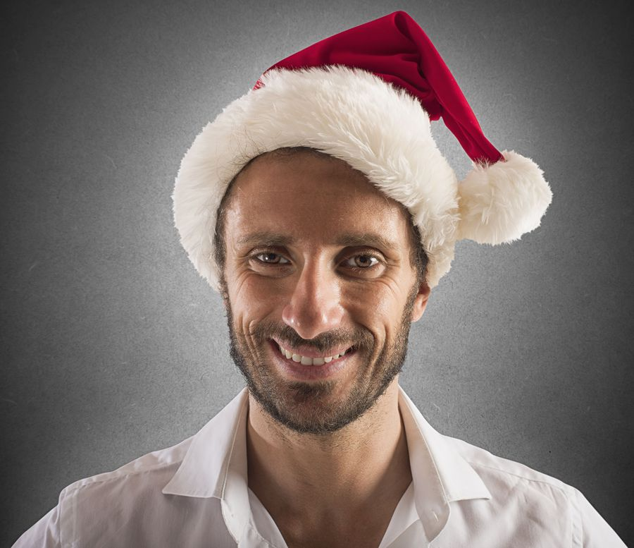 Smiling businessman with hat of Santa Claus